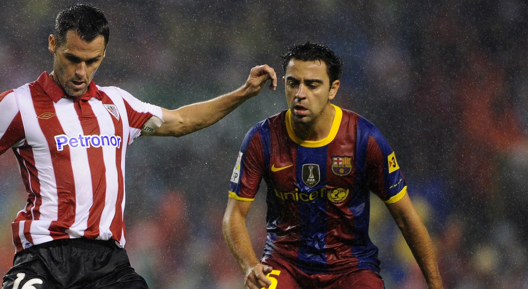Xavi y Orbaiz en un Athletic - Barcelona